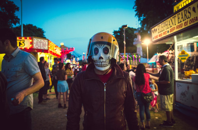 Frank Aberdean Something Wicked This Way Comes by Mako Miyamoto skull skeleton horror killer red day of the dead superhero leather badass visor carny circus lights carnival summer