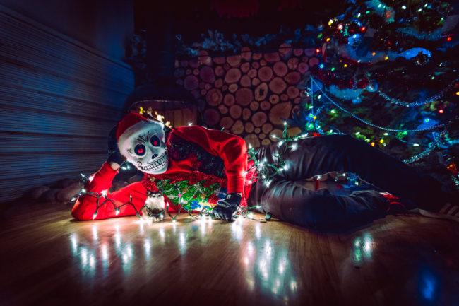 Frank Aberdean Season's Greetings by Mako Miyamoto skull skeleton horror killer red day of the dead superhero leather badass visor happy holidays christmas lights red