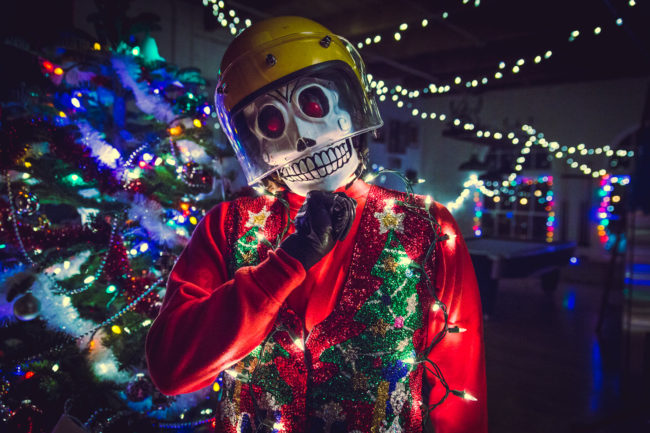 Frank Aberdean Season's Greetings by Mako Miyamoto skull skeleton horror killer red day of the dead superhero leather badass visor happy holidays christmas lights red