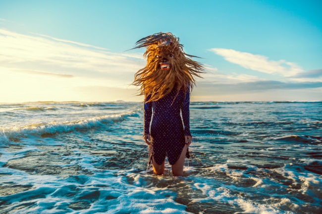 Photograph by Mako Miyamoto. Wookie standing in the ocean waves in oregon shaking her hair in the golden glow of the sun