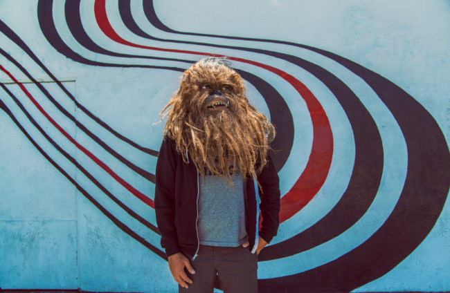 Mako Miyamoto - Figure 8. Wookie standing in front of the Figure 8 Wall on Sunset Boulevard in Los Angeles, California