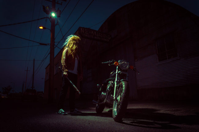 2:48 am Photograph by Mako Miyamoto. Wookie with a bat standing at night under a streetlight with a motorcycle. Part of the Holding Off Eternity series for a show at Gallery 135 in Portland, OR