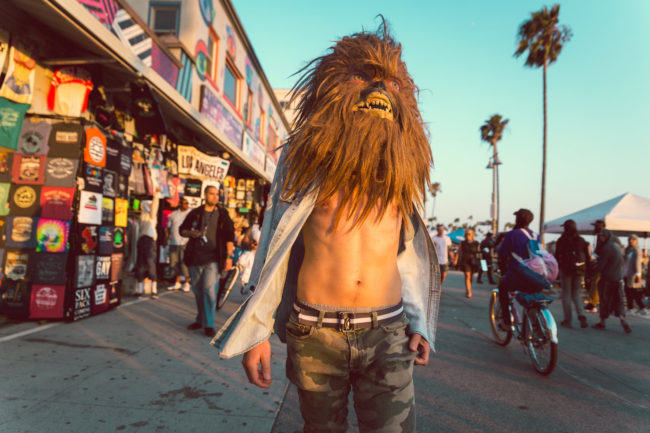 California Dreaming Photograph by Mako Miyamoto. Wookie walking in Venice Beach California with his shirt open in the afternoon