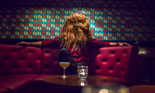 Photograph by Mako Miyamoto. Wookie sitting in the VIP area at a club in London