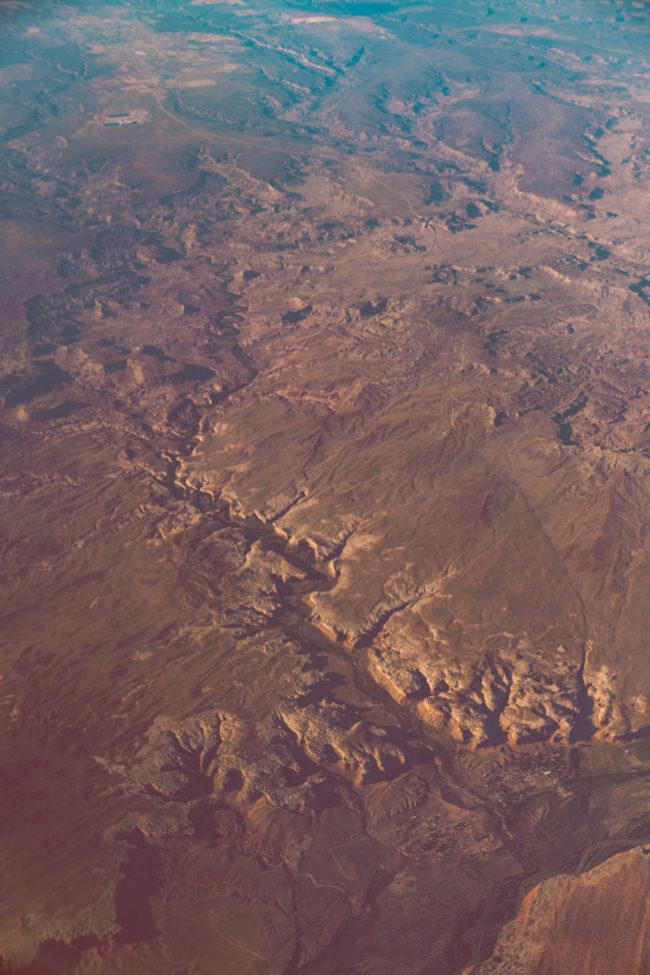 Falling Up by Mako Miyamoto clouds sky blue flight travel mountains photography desert