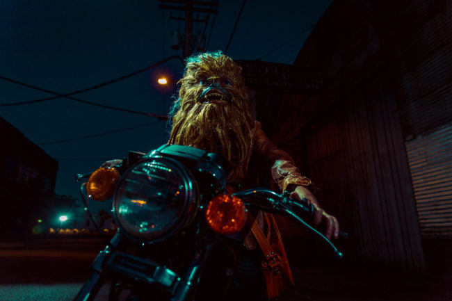2:53 am Photograph by Mako Miyamoto. Wookie badass riding a motorcycle at night under a streetlight. Part of the Holding Off Eternity series for a show at Gallery 135 in Portland, OR
