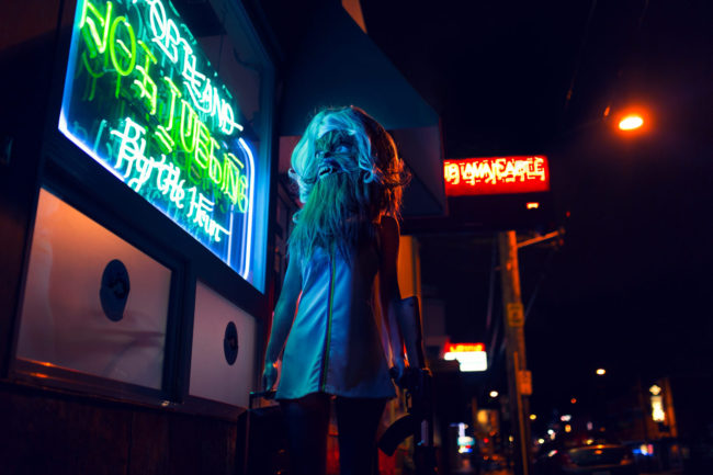 Tears in Rain I Photograph by Mako Miyamoto. Blade Runner wookie woman with an AK-47 walking by a neon sign in the red light district. Part of the Speculative Hunting series for a show at the Gauntlet Gallery in San Francisco, CA